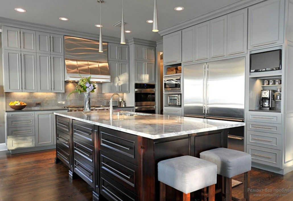 Boxed design of the large steel color decorated kitchen with the square island