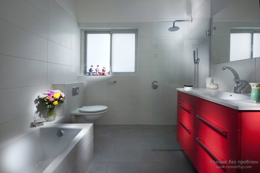 Red accentual vanity in the minimalistic interior of the modern bathroom