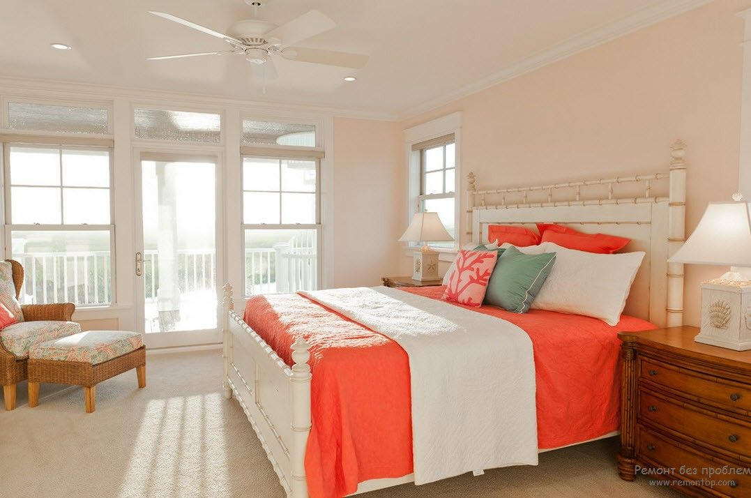 Bright accent of the coverlet in the Casual styled bedroom