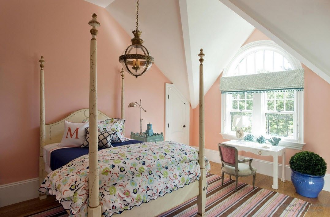Complex loft design of the Classically decorated bedroom with peach painted walls