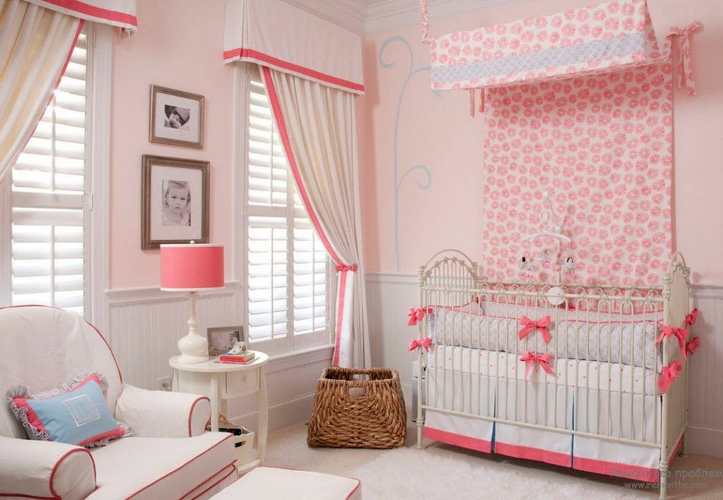 Pale pink curtain of the canopy over the child's berth