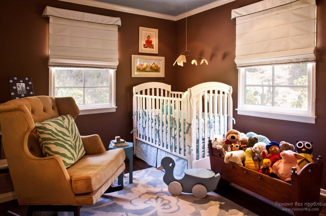 White crib in the almost totallu chocolate painted nursery