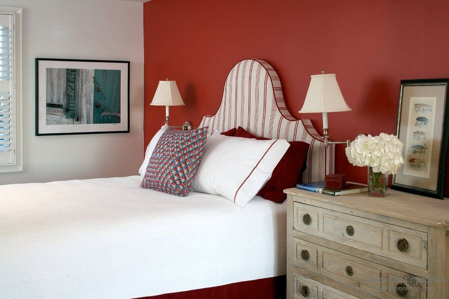 Bold decision of red wall decorating the headboard wall