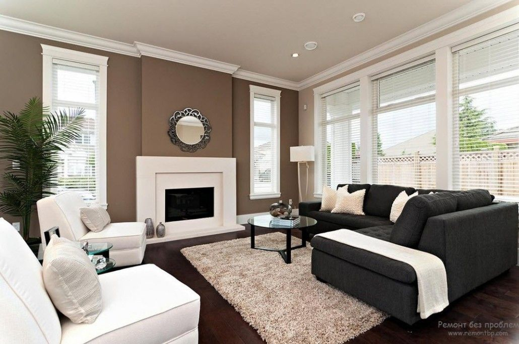 Brown accent wall with the mirror and fireplace