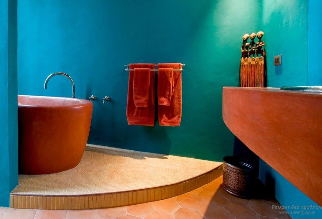 Saturated peach color in the bathroom with posium and azure painted walls