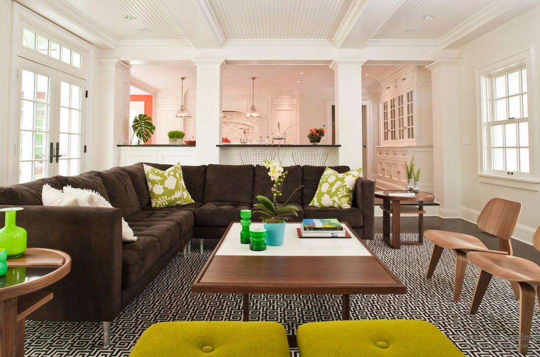 Aspid yellow chairs and brown decoration of the spacious living zone in the house