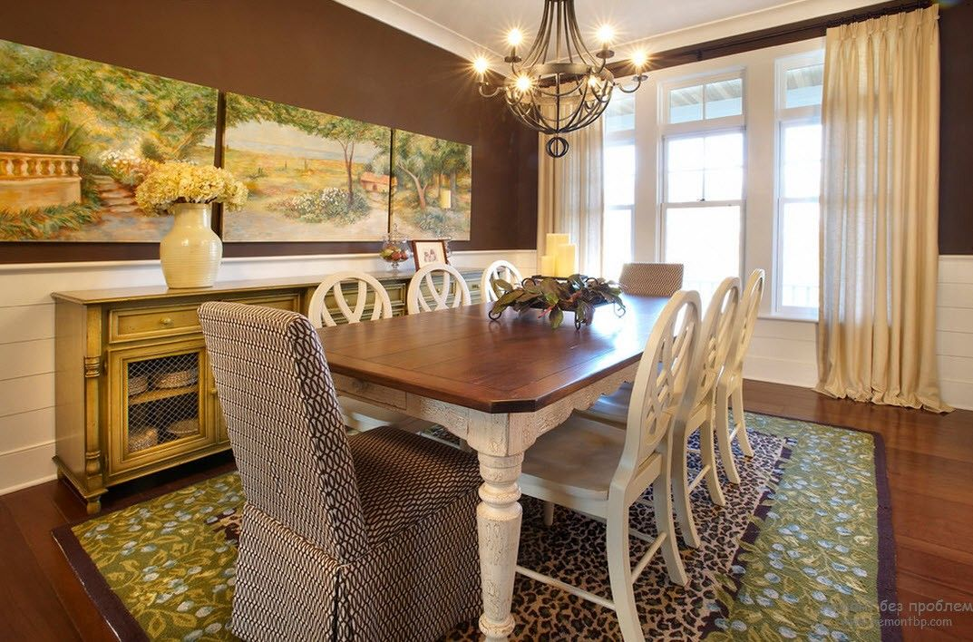 Classic style for the dining room with brown walls and table, set off by milky furniture