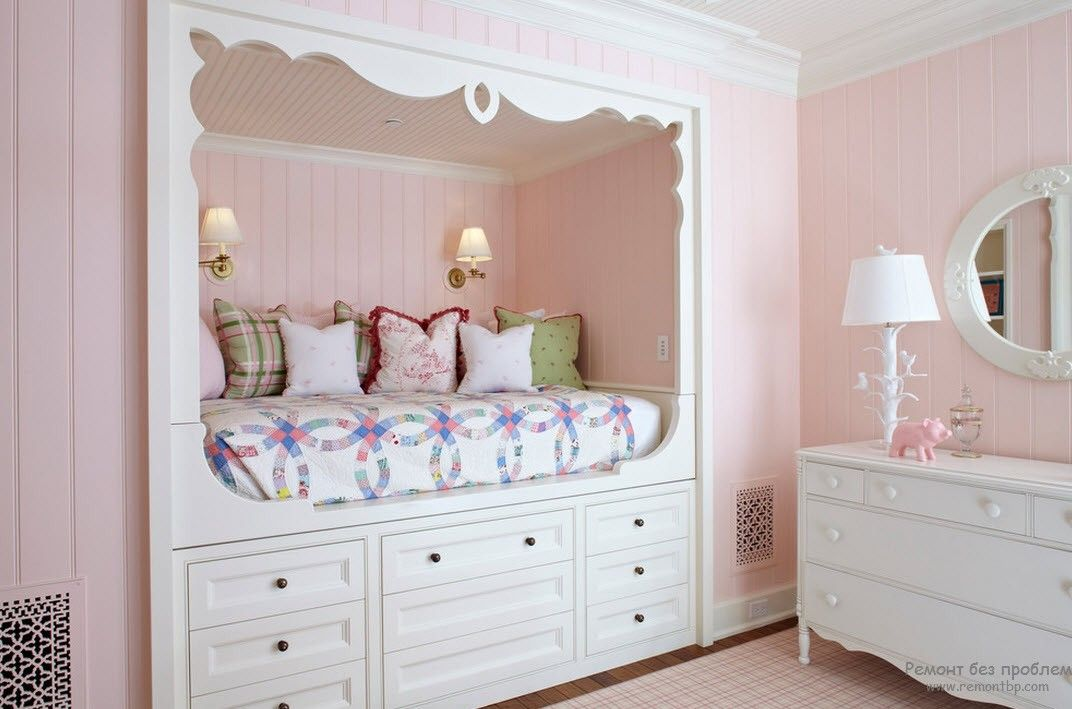 Nursery with white podium bed and pink decoration around