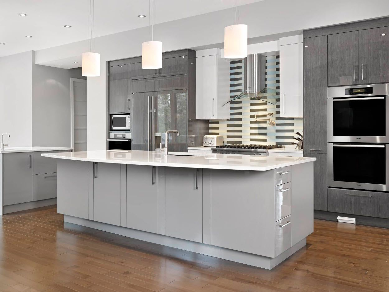 Gray Color Interior Decoration. Simple Elegance for Your Apartment. Grandeur hi-tech kitchen with large functional inwards