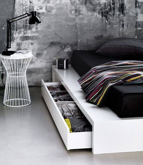 Vintage touch of industrial styled dark bedroom with folding out storage under the bed