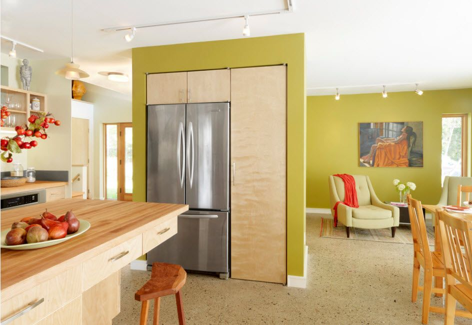 Unusual design of the kitchen with olive painted walls