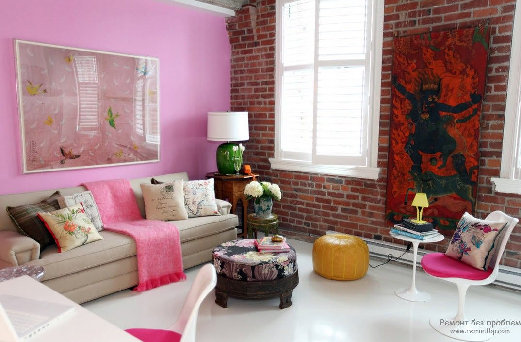 Loft living room with pink accent wall