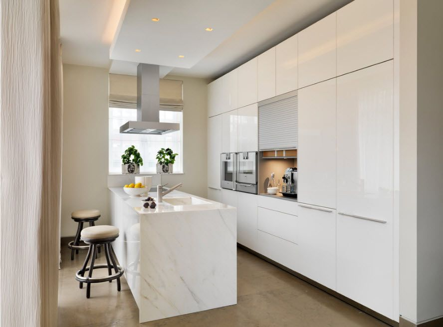 HI-tech designed kitchen with smooth glancing plastic glass and surfaces