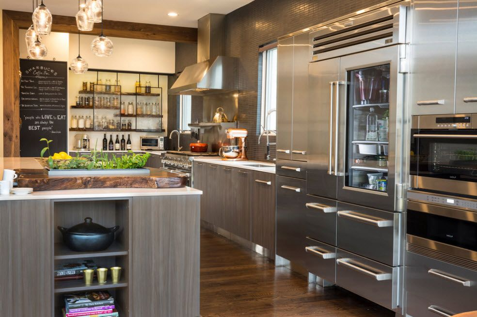 Gray steel surfaces for spacious modern kitchen