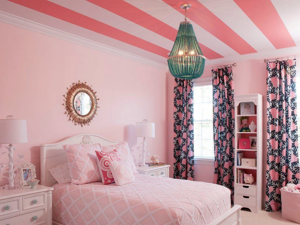 Colorful kids' room with striped in pink and pale rose color ceiling