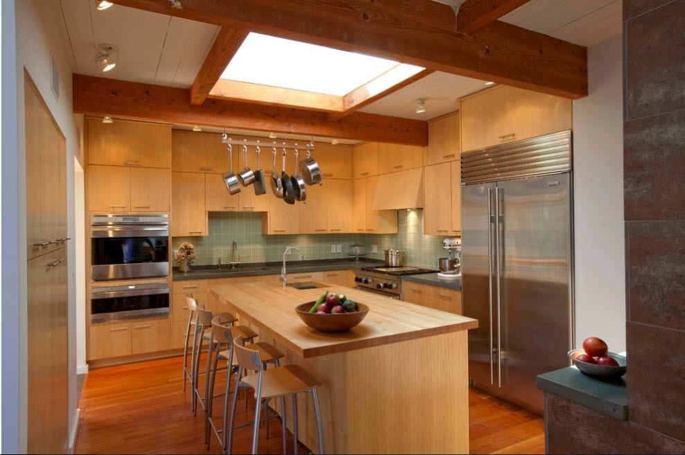 Skylight in the wooden trimmed ceiling for Rustic however modernly stylished kitchen