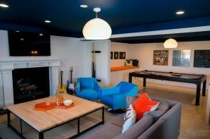 Dark blue ceiling and modern youth interior with gray, turquoise and orange elements
