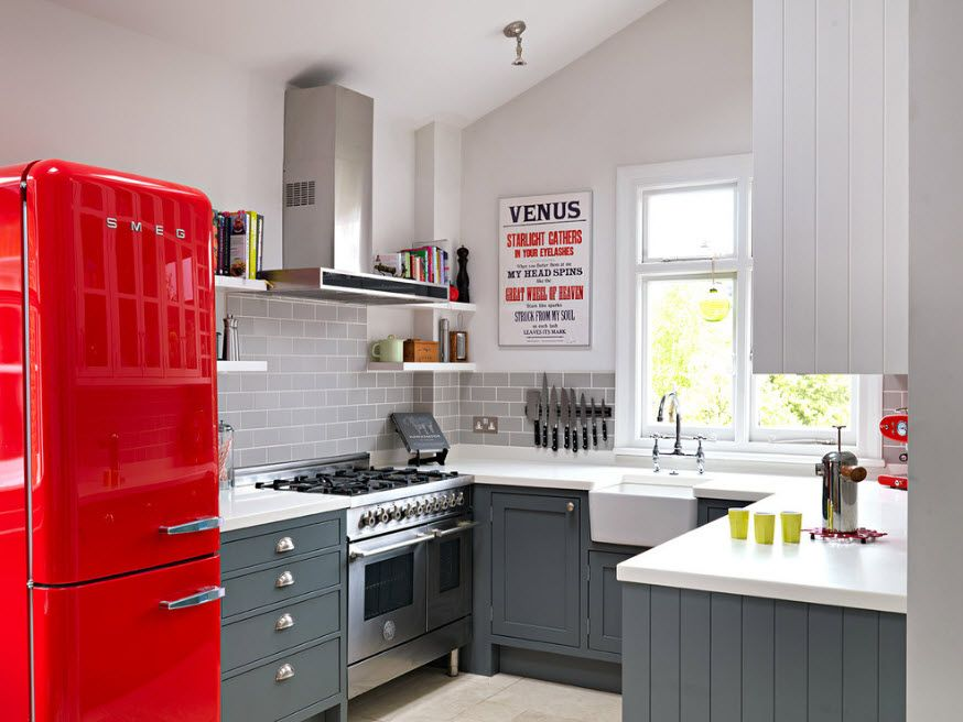 Casual styled kitchen interior with contrasting red refrigerator
