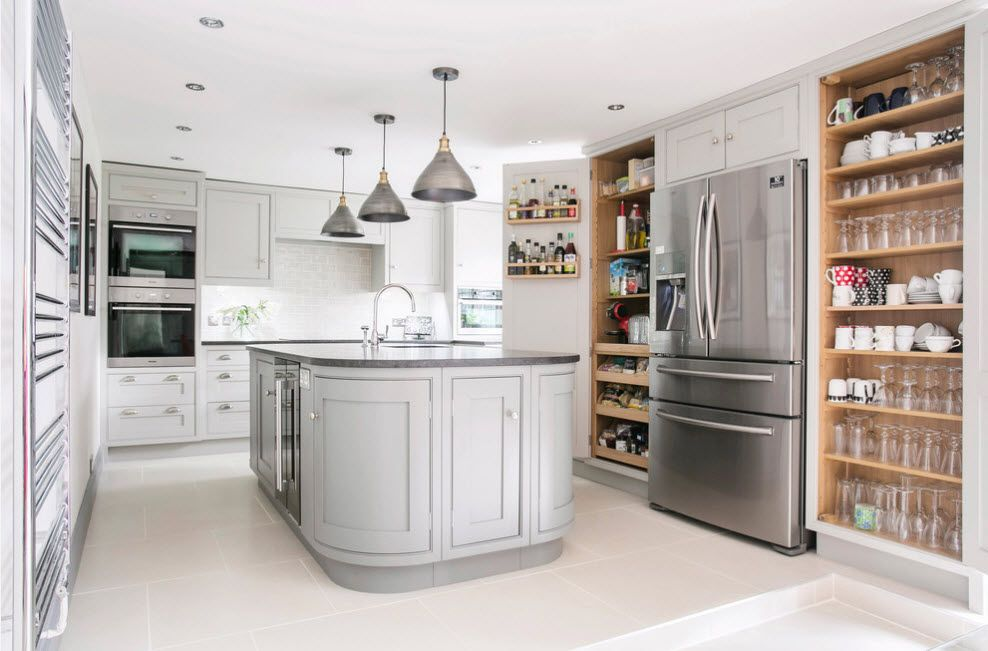 Refrigerator in Modern Kitchen Interior Design. Casual and Classic styles symbiosis in the large studio apartment