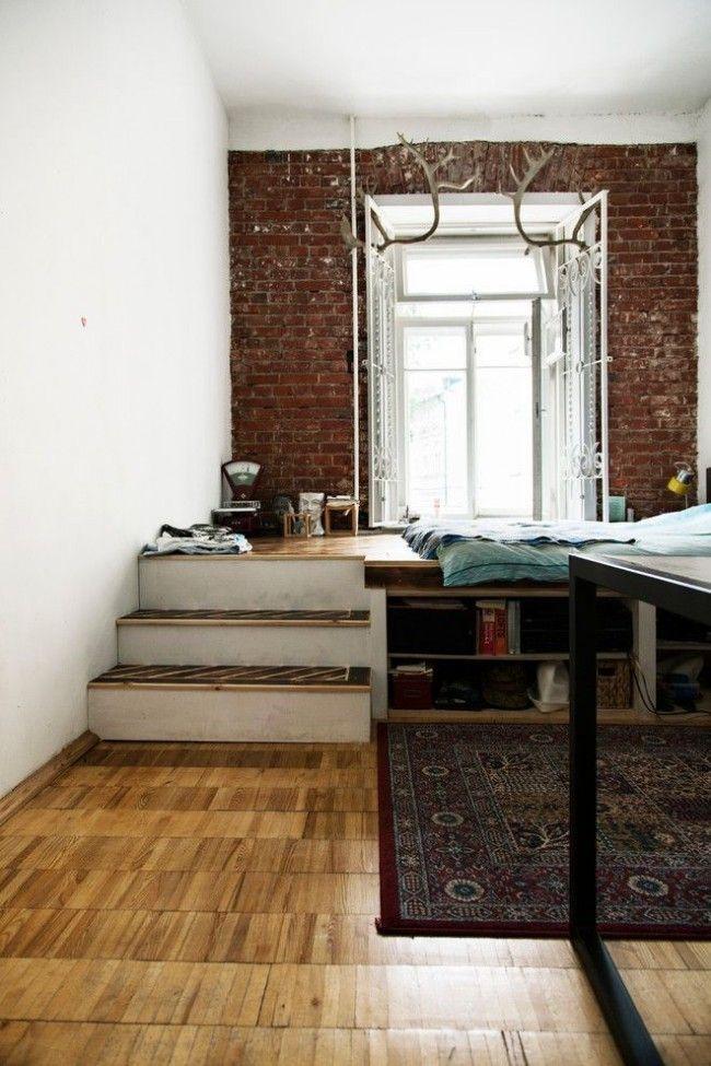 Striking industrial motiffs for the modern studio apartment with the sleeper near window