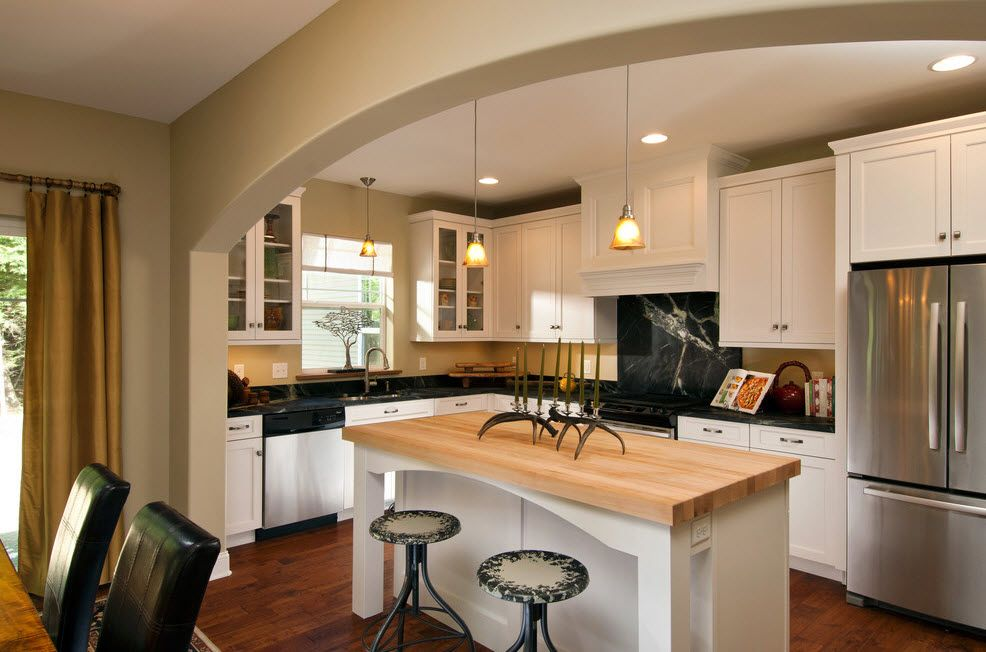 Refrigerator in Modern Kitchen Interior Design. Wooden countertop for ambience with Rustic notes zoned by a ceiling vault