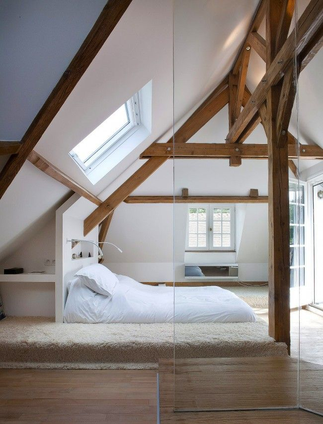 Grand loft interior example with white finishing and natural wooden open ceiling beams