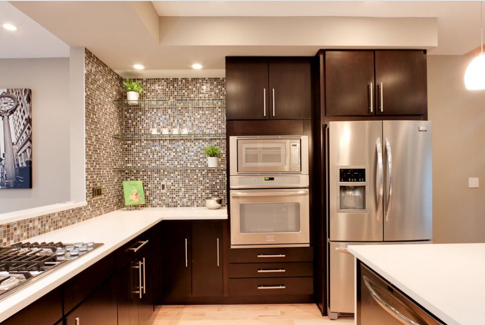 Refrigerator in Modern Kitchen Interior Design. Gray and brown contemporary color intermixing