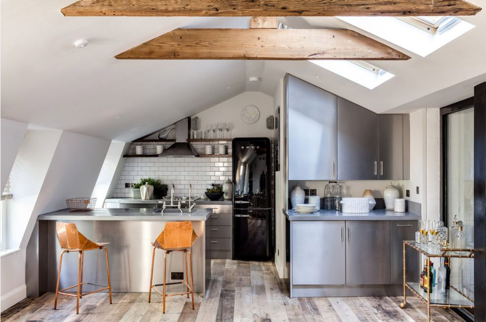 Open ceiling beams and the bleached laminate for the modern deisgned kitchen with gray facades