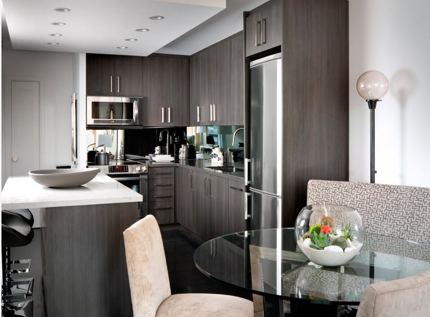 Gray shades for the modern designed kitchen with U-shaped furniture set