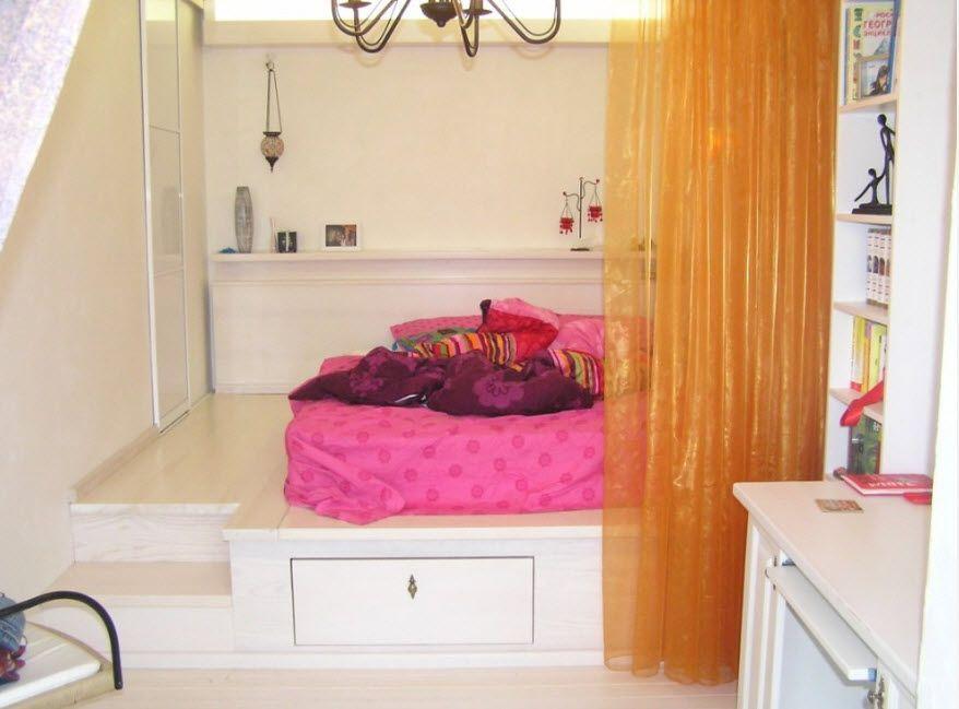 The podium bed with orange PVC curtain
