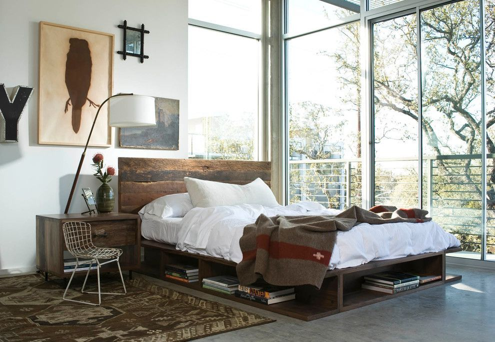 Podium Bed. Luxury or Functional Interior Element? Loft style in open layout bedroom with panoramic windows