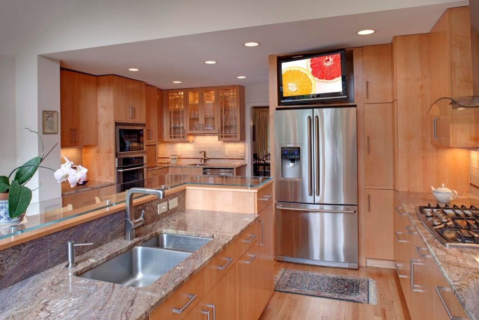 All wooden modern kitchen design with glancing steel surfaces
