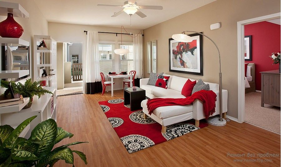 Red Color Interior Decoration. Versatility of Red Shades. Open layout for the large living room with the carpet at the rest zone