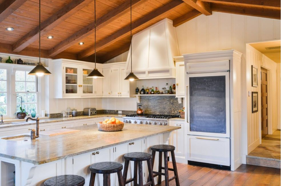Open contrasting wooden slanting ceiling beams and pastel colored Classic set interior of the kitchen