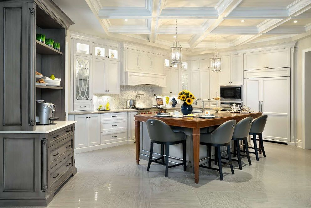 Glancing white milky concrete floor at the cintage decorated kitchen with dining zone