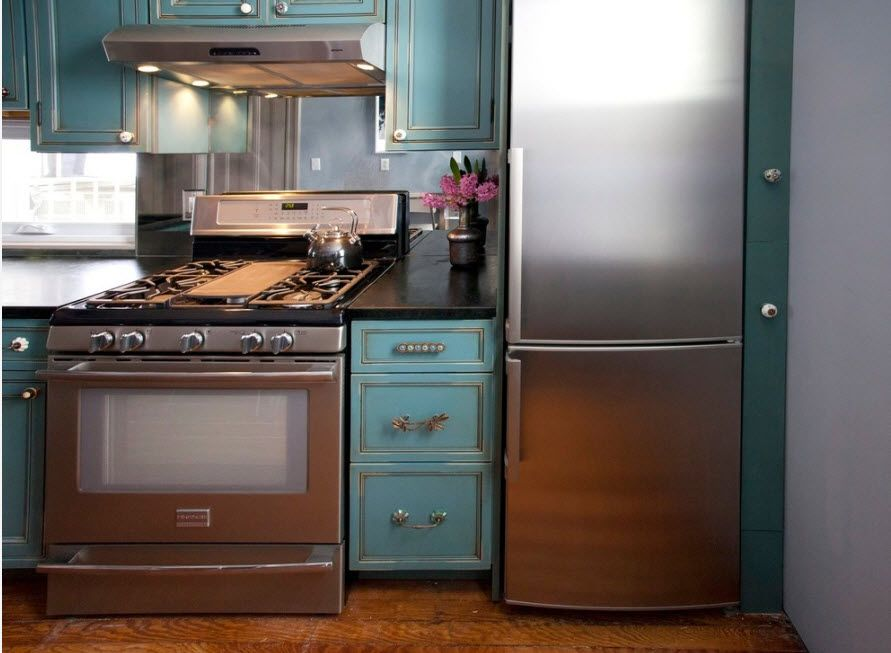 Refrigerator in Modern Kitchen Interior Design. Azure funriture set and walls coloring
