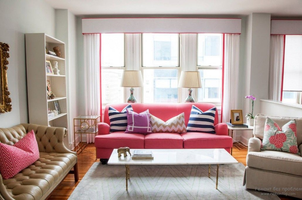 Nice pink sofa with striped pillows in the living room