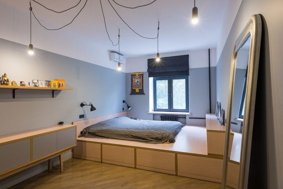 Podium Bed. Luxury or Functional Interior Element? Industrial and loft motiffs in the large men's cave