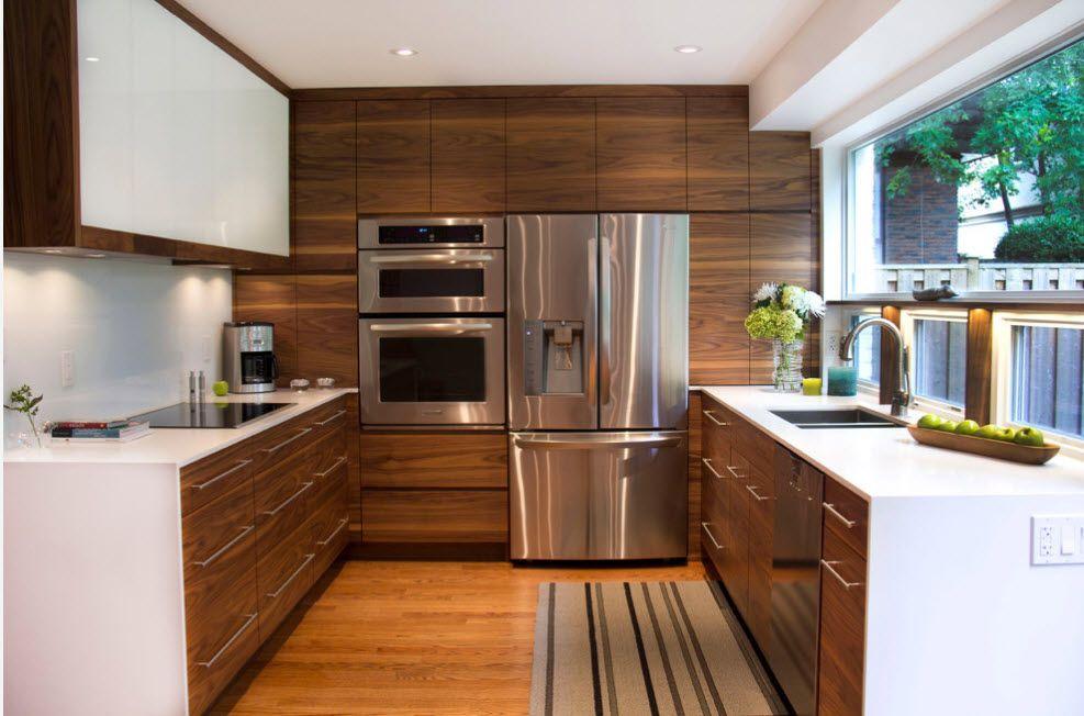 Noble oak trimmed furniture set in the kitchen