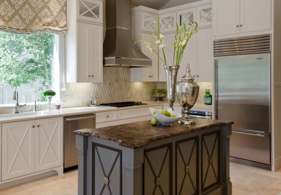 Classic interior design with lamrequins, dome extractor hood and wooden kitchen island with crossed planks decoration