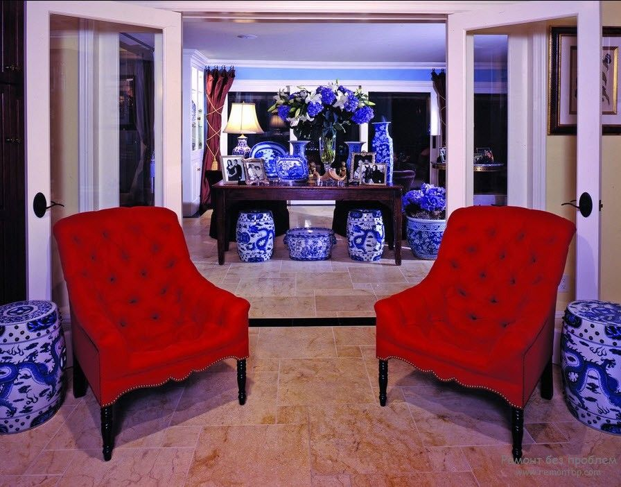 Red Color Interior Decoration. Versatility of Red Shades with two arnchairs in the living room
