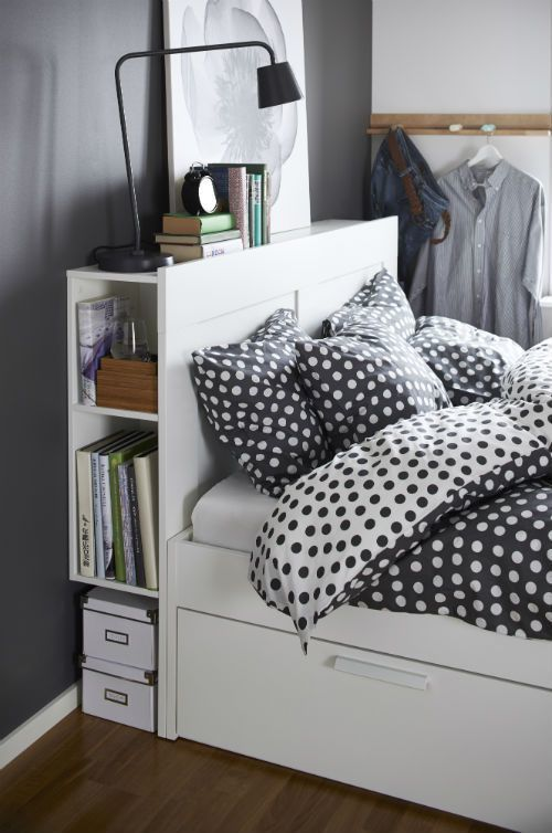 Simple tranquility of the bedroom in gray neutral tones and the improvised library right at hand