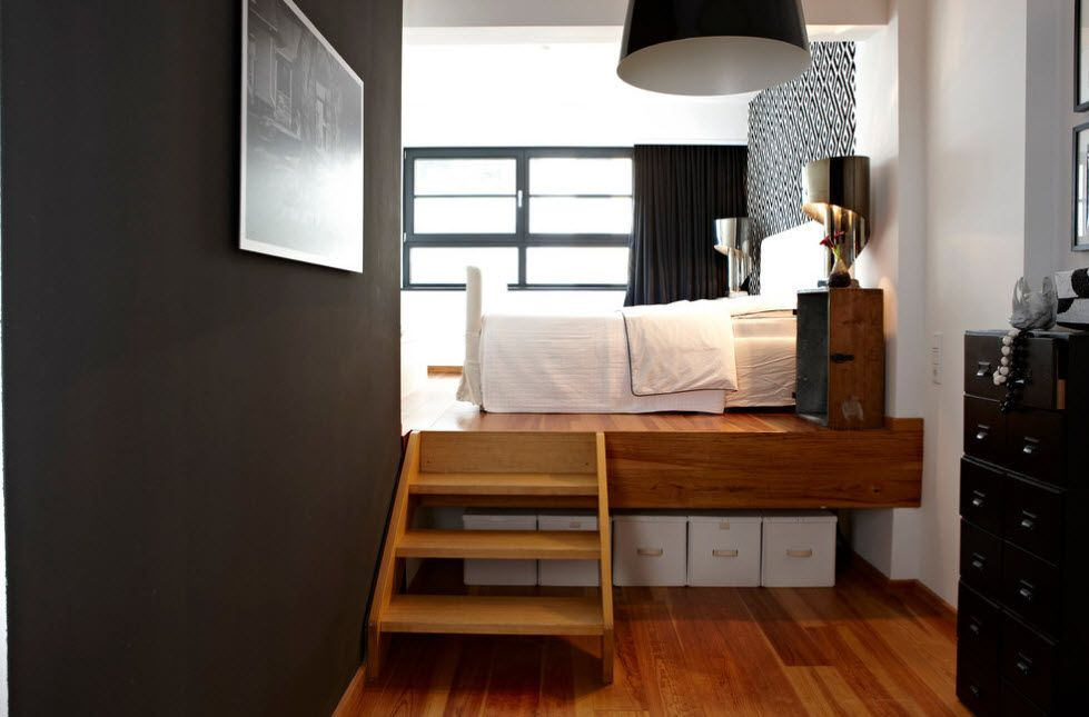 Dark contrasting accent wall and the stairs for the podium bed at the window