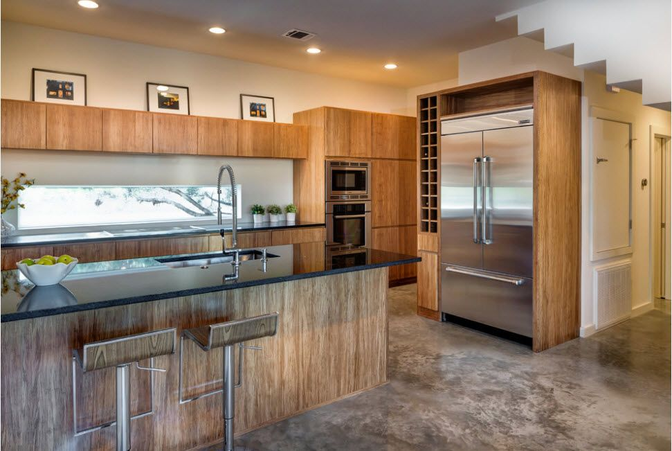 Wooden kitchen design with steel protruding refrigerator surfaces