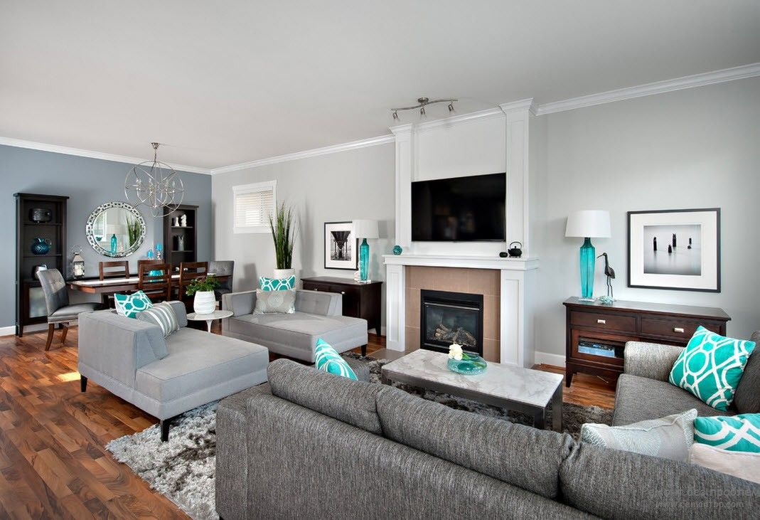 Aged Casual design in the gray toned living room with bright turquoise notes