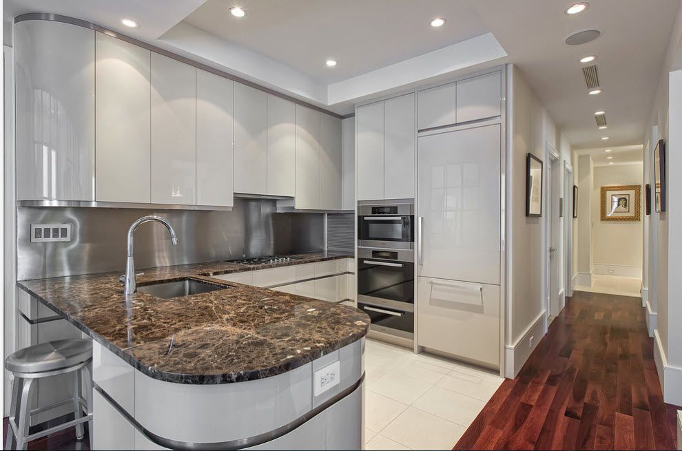 Marble top island in the gray finished kitchen