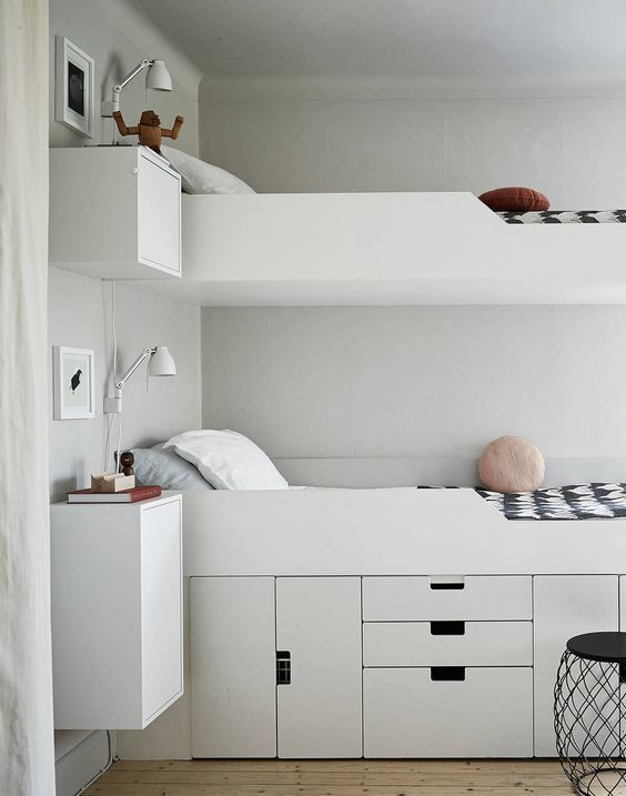 unusual bunk bed design with the storage systems under the first level