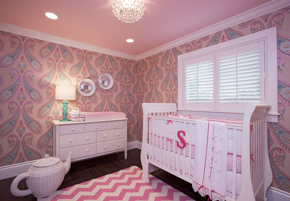 Tender pink nursery with drawing wallpapered walls