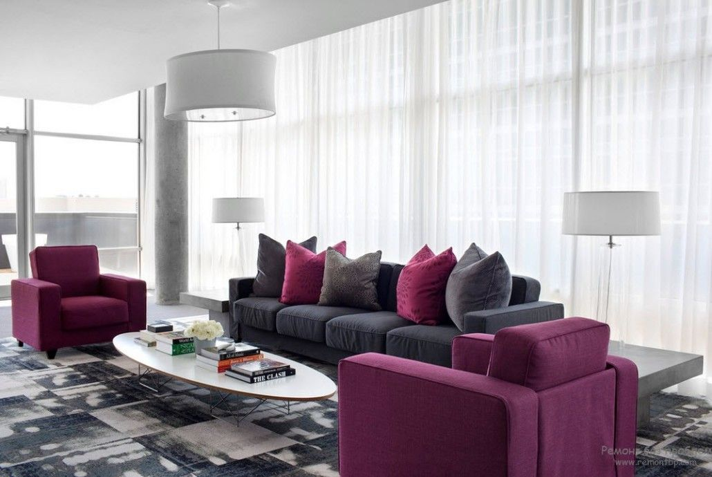 Large living room in minimalistic style and with the tulle on windows