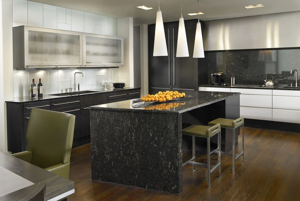 Dark contrasting kitchen island in the large room with olive touch